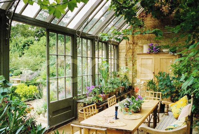 Conservatory . A <b>greenhouse</b> <b>attached</b> to a <b>house</b> for the display of ...