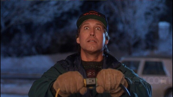 Chevy Chase is joyful when the Christmas lights light up the house ...