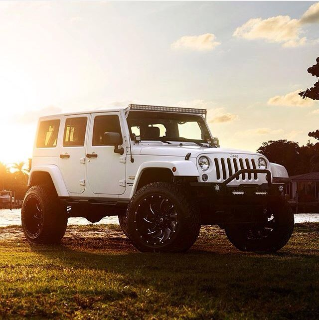 Jacked Up Jeeps White