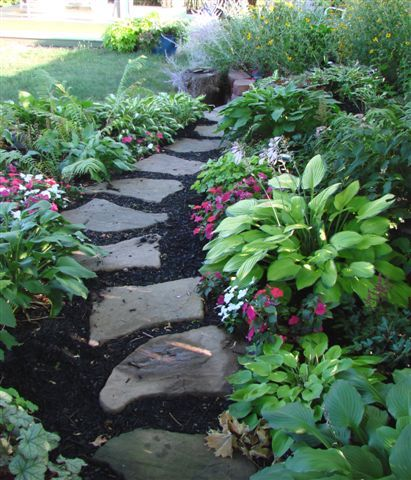 Flagstone garden path   I also have flagstone paths through my garden    love the way they age and get mossy I like this for my shade garden  a good way to expand outward  . Garden Paths And Stepping Stones. Home Design Ideas