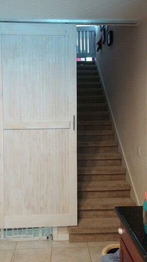 Barn Door With Pocket Track Mounted To Ceiling At Bottom