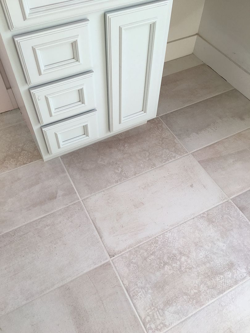 Beautiful distressed patterned tile powder room bathroom for Mudroom floor