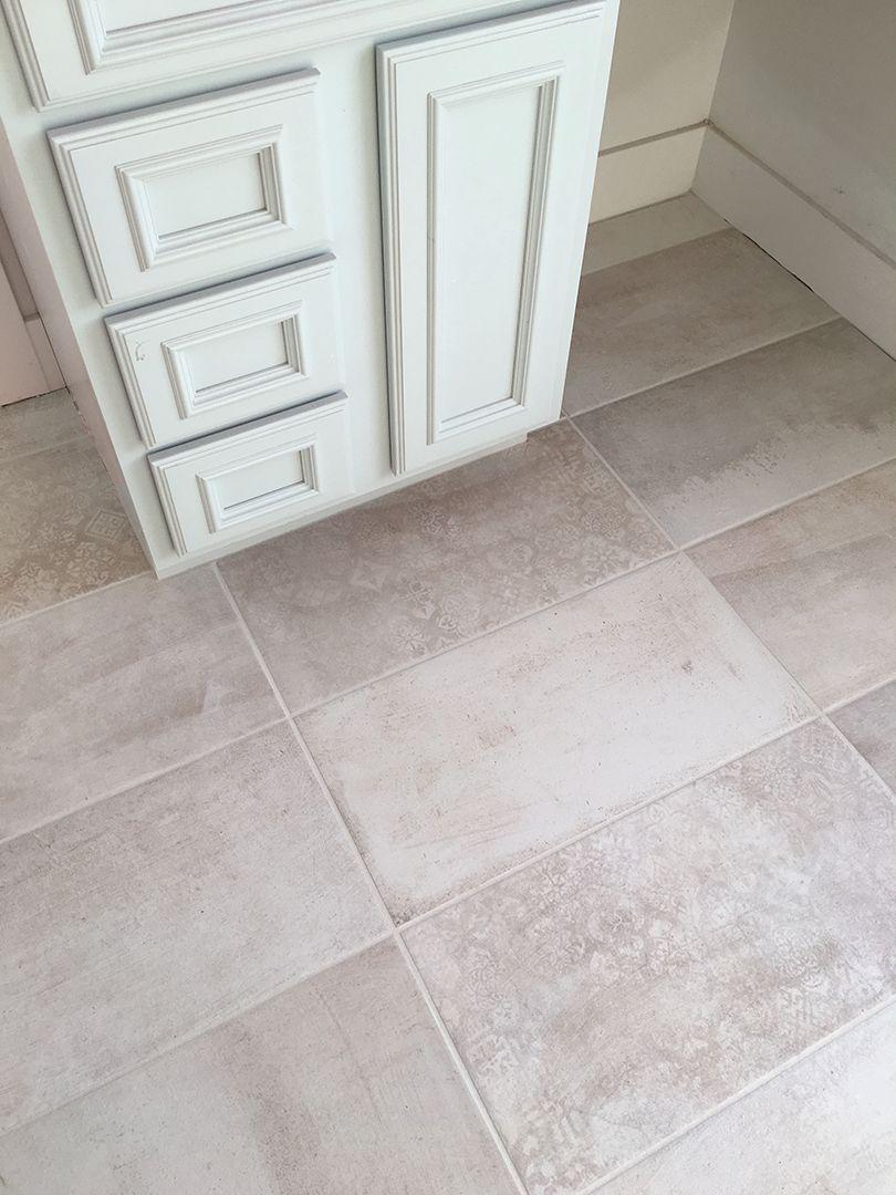 Beautiful Distressed Patterned Tile Powder Room Bathroom