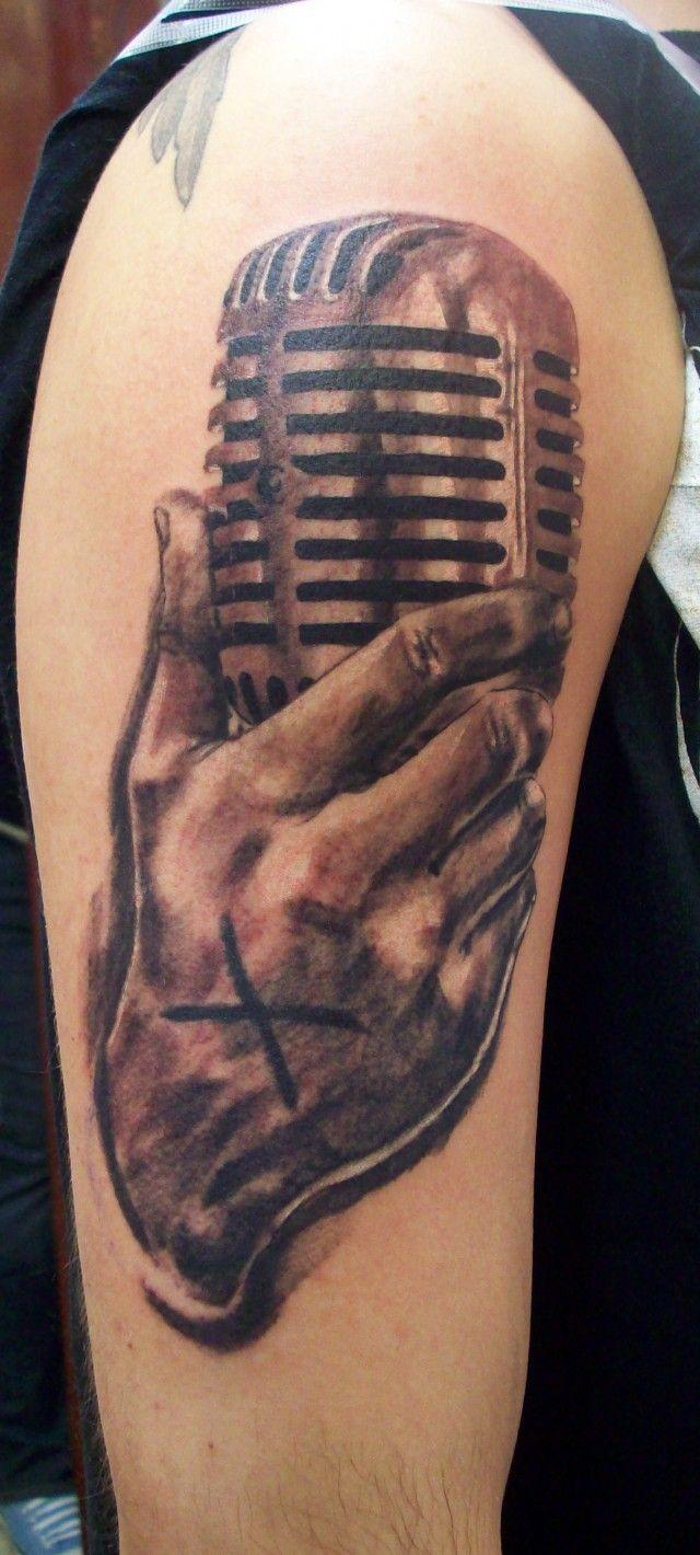 Hand Holding Microphone Tattoo
