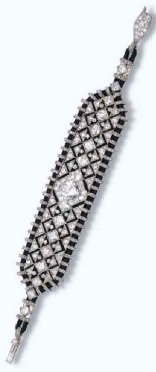 CARTIER - AN EXQUISITE ART DECO BRACELET, CIRCA 1925. Of geometric diamond openwork design with a central cushion-shaped diamond to the black silk cord frame and velvet backing, with French assay marks for platinum and gold Signed Cartier, numbered. #Cartier #ArtDeco #bracelet