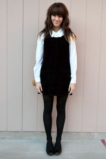 628cf1d6bf085 Black jumper + white button down + black tights. I'd add a bright statement  necklace.