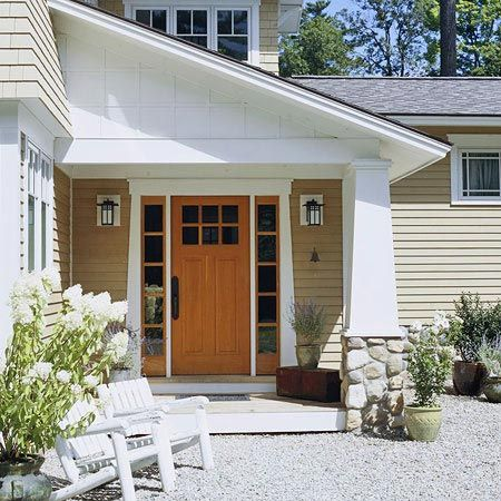 This gorgeous entryway stands out. See more exterior doors: http://www.bhg.com/home-improvement/door/exterior/exterior-doors-and-landscaping/?socsrc=bhgpin080612whitetrimentry