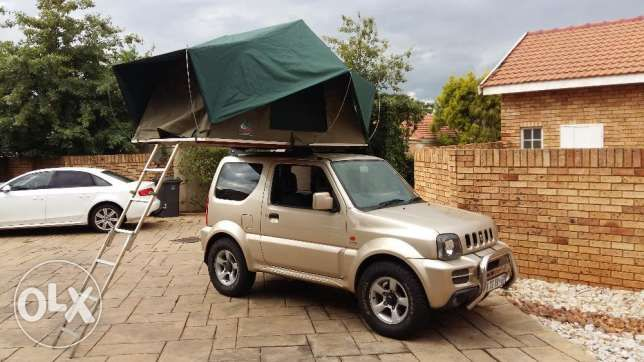 Jimny nudge bar tow bar spearwheel cover Frontrunner roofrails(still have the originals). ps the rooftop tent is not included & 2009 Suzuki Jimny Special Edition Centurion - image 2 | Zooks ...