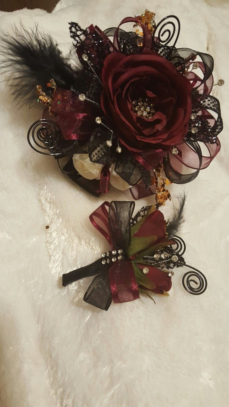 Burgundy and black corsage set from hen house designs httpswww hen house designs full service silk florist in denham springs la can assist you with wedding flowers or any occasion or event mightylinksfo Choice Image