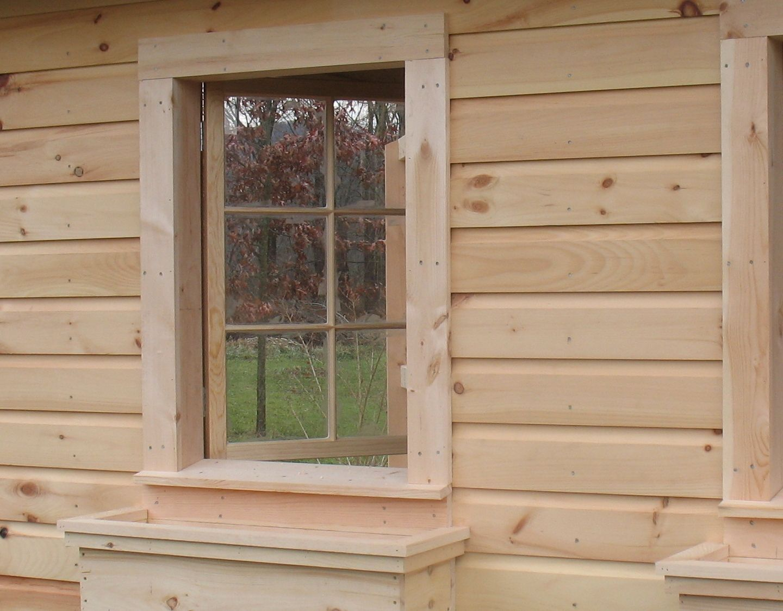 The barn sash windows open to the inside. Very nice flower box ...