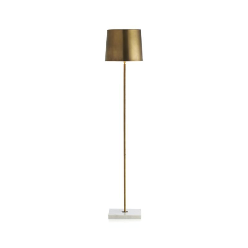 From Its Cool White Marble Base To Its Warm Antique Brass Shade