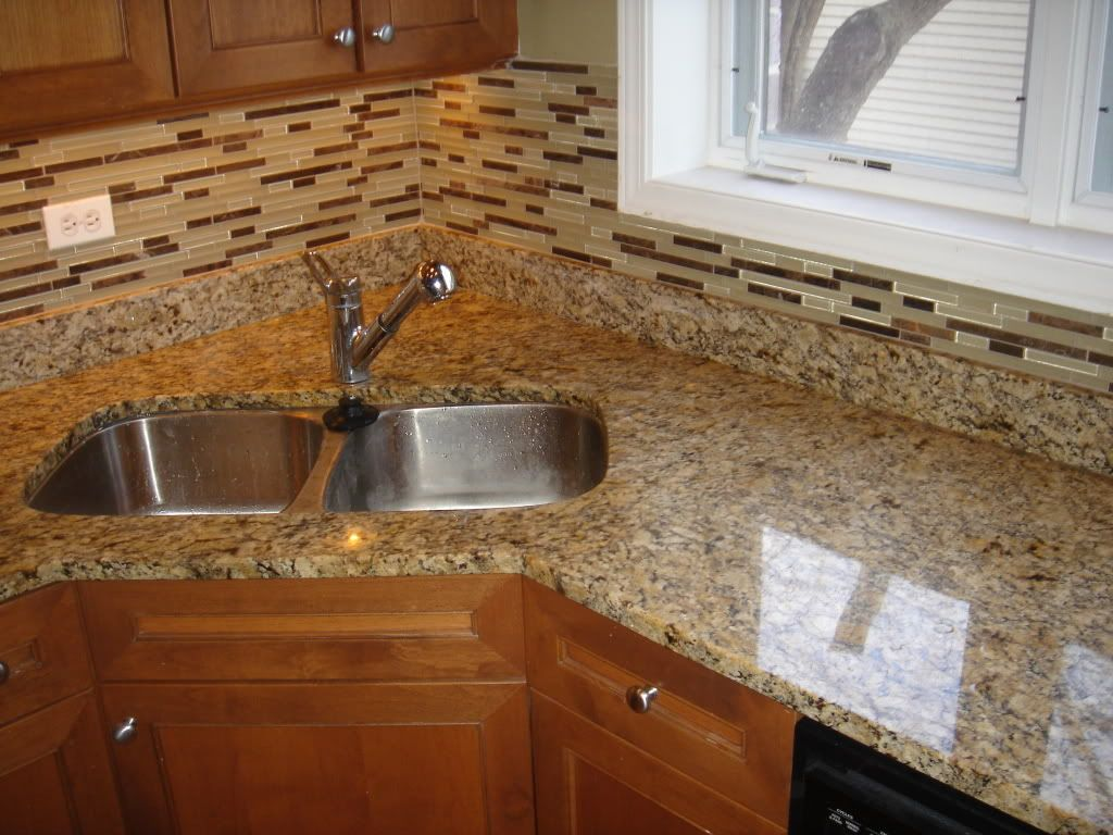 - Giallo Ornamental Granite Countertop And Matching Glass Backsplash