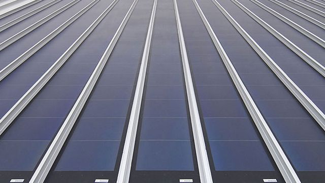 Standing Seam Mtl Roof With Solar Panel Strips Solar