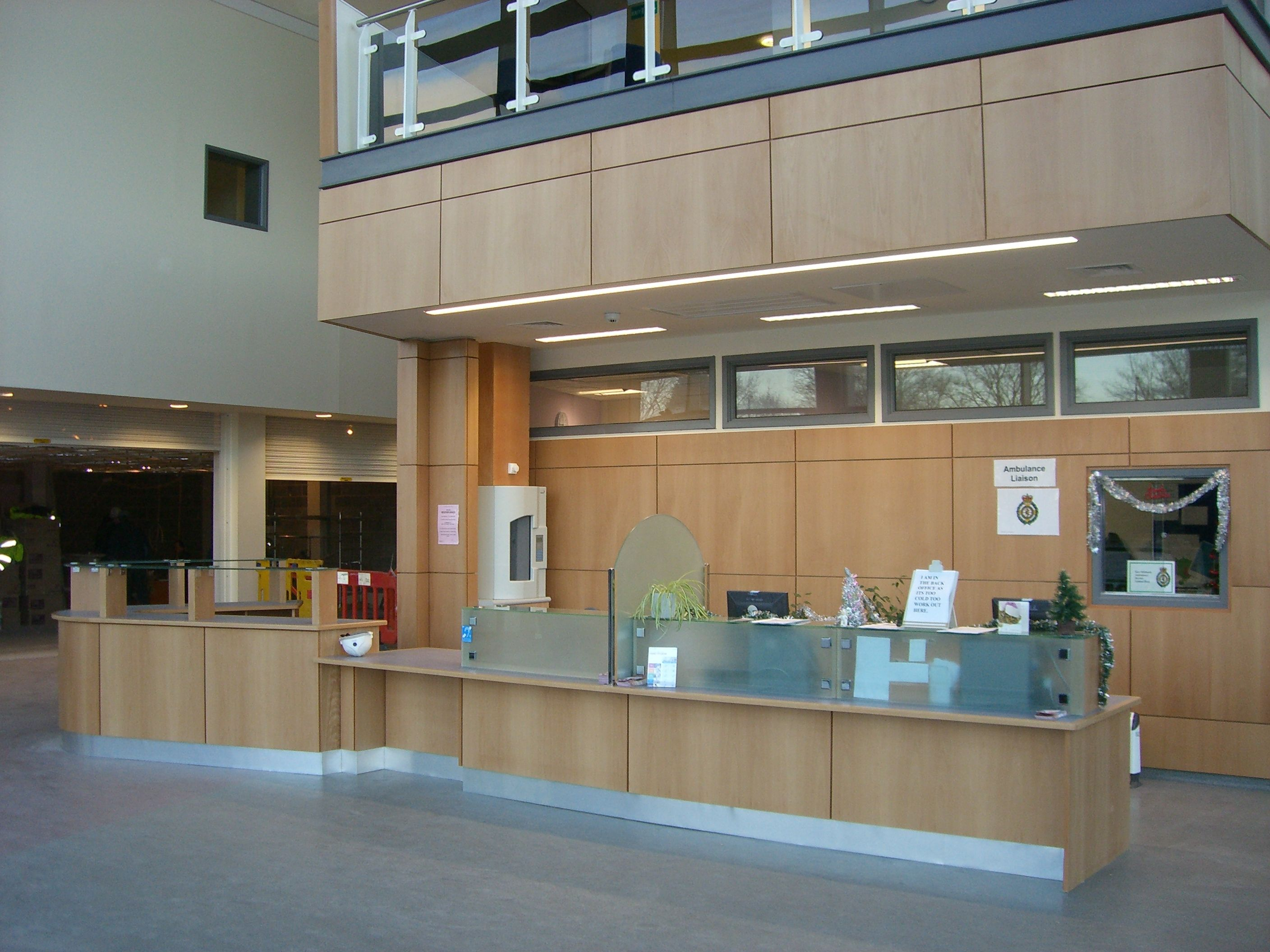 local hospital main reception desk in beech veneer and panel