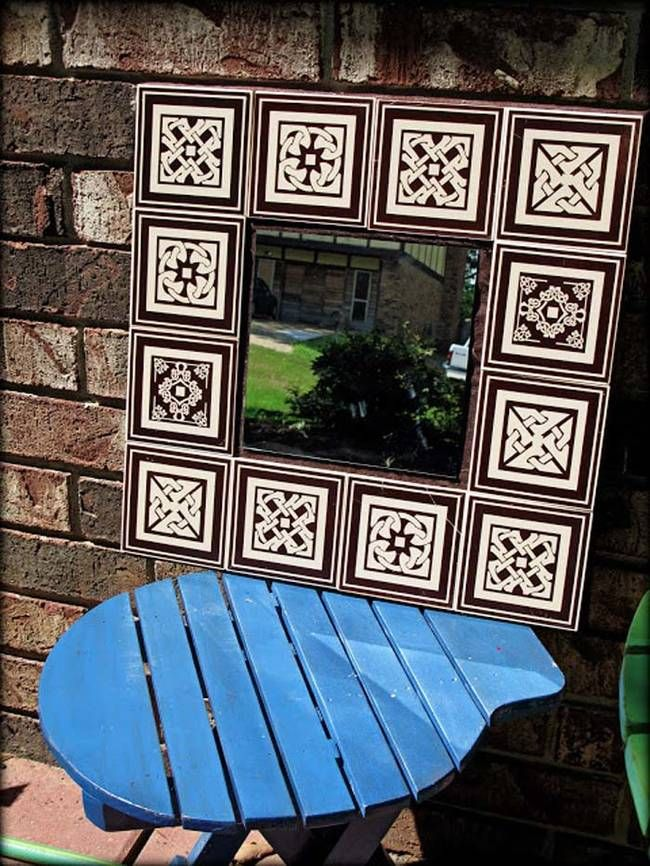 14.) Dollar store tiles and an old mirror make up this outdoor ...