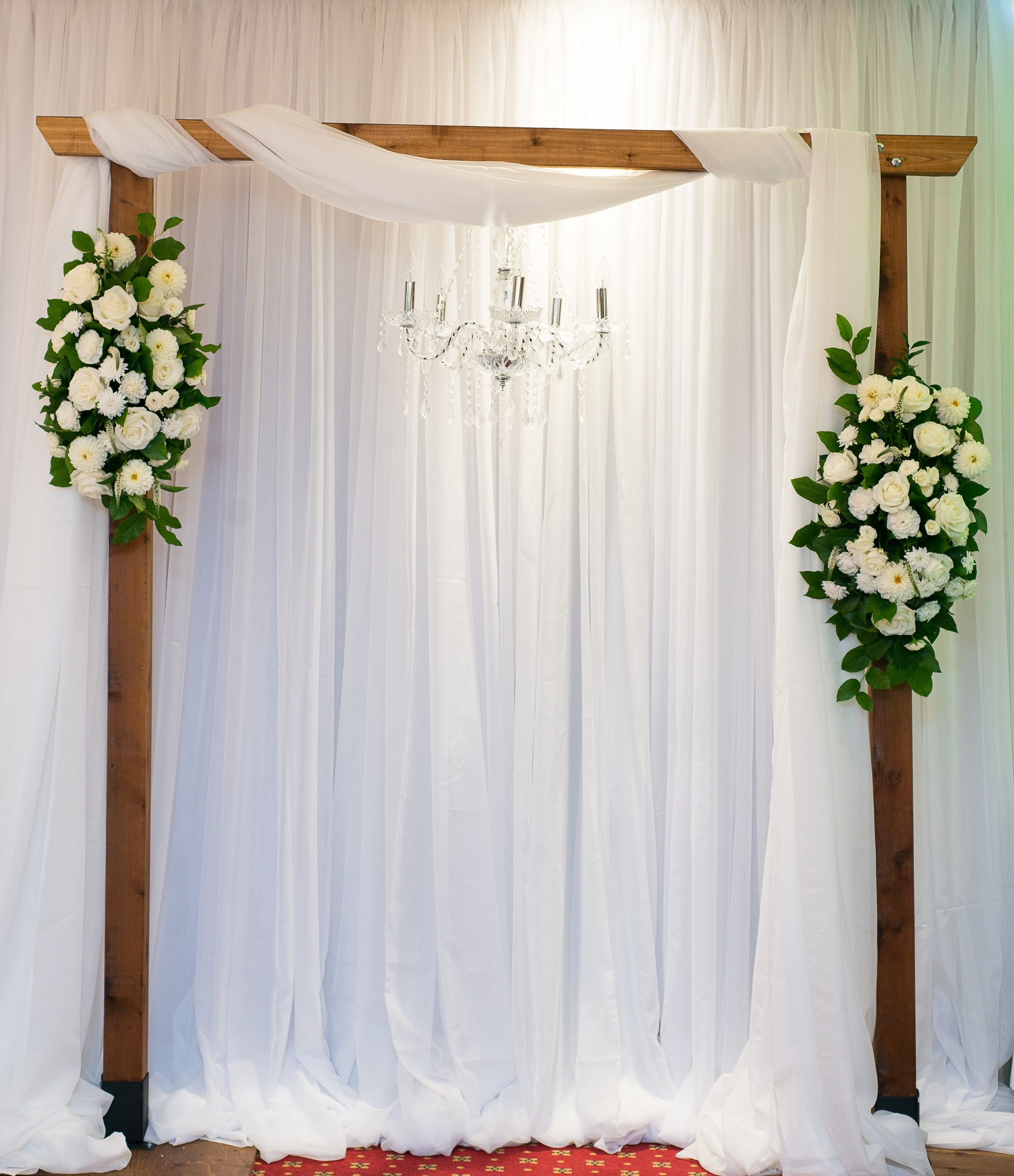 Rustic wooden ceremony arbour, chandelier Photo: DA Photography ...