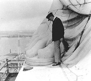 Photo of Statue of Liberty's foot with a man standing next to it
