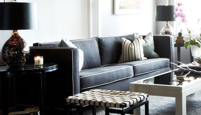 sofa negro ribeteado blanco
