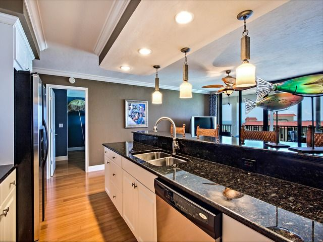 Coastal Contemporary Condo Kitchen   Black Granite   Pendant Lights   Fish  Art. Vanderbilt Gulfside