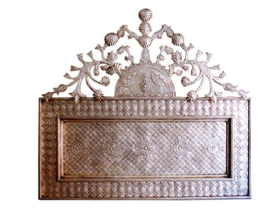 Love this Mexican-style silvery tinwork headboard - mounts to the