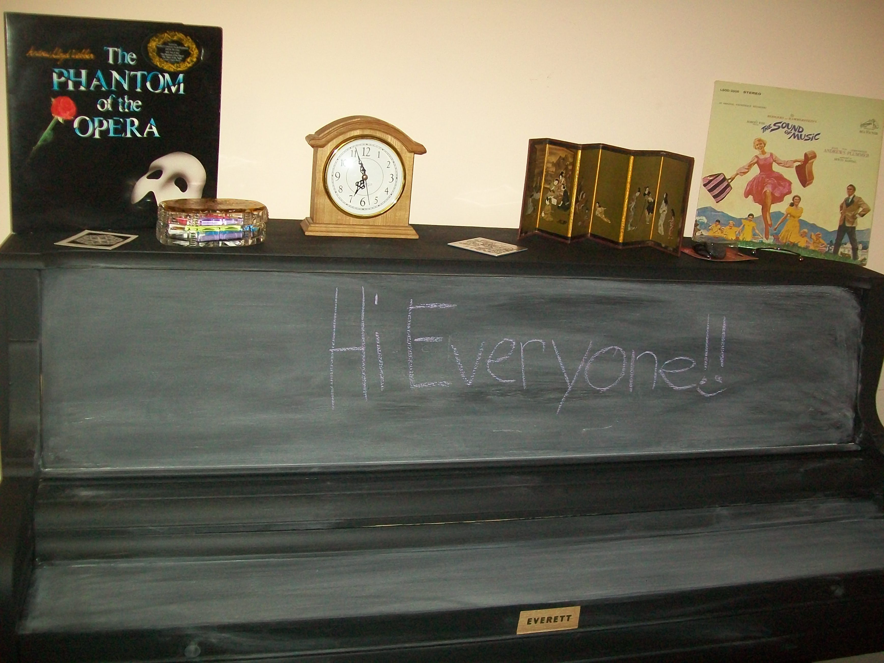 When we got this piano it was really ugly so we painted it with chalkboard paint (never paint the back panel of a piano or it will change the sound). This is great for piano teachers like me!