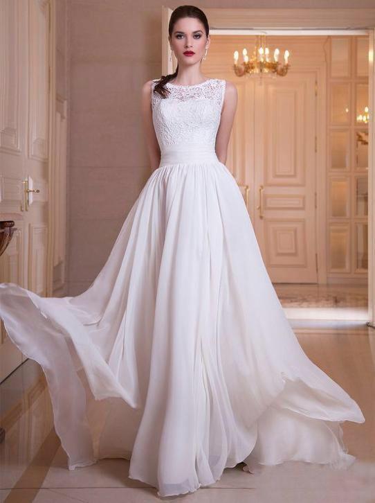 Mooie zwierige trouwjurk met chiffon rok en top van kant
