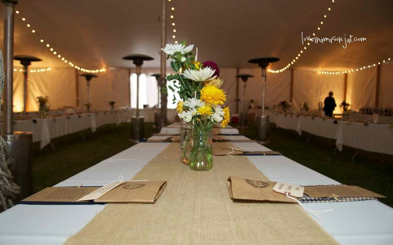 Mason jar centerpieces love the burlap runners and pops of yellow