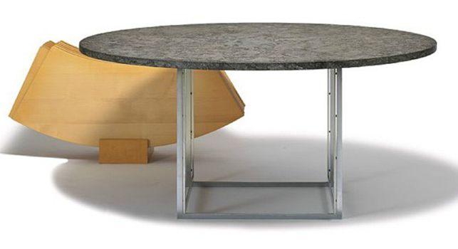 Poul Kjærholm. Bordet PK54. Flintrullet porsgrunn-marmor bordplade. Tillægsring af ahorn.