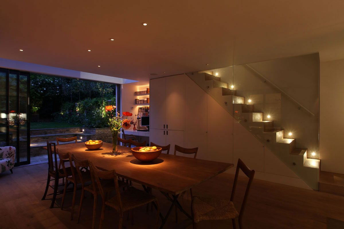 modern dining room light not centered over table | lighting design