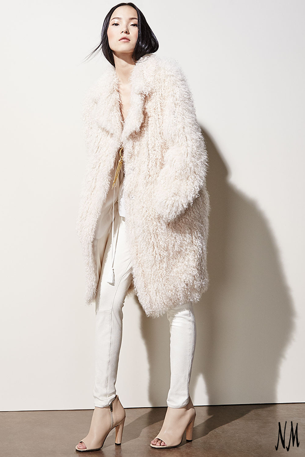Take white into night with this luxe oversized shearling coat by Elizabeth and James. Mix tones and textures with winter white vegan leather pants and nude booties.