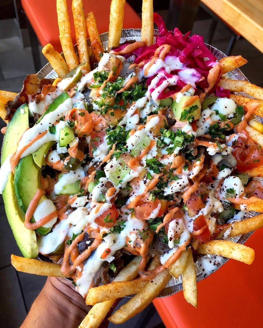 Turkish Street Fries: fresh fries topped with grilled onions, beef Döner kebab, shepherd's salad, corn, jalapeños, red cabbage, parsley, feta cheese, avocado and Döner G sauce  : @dailyfoodfeed /: @donerg #forkyeah