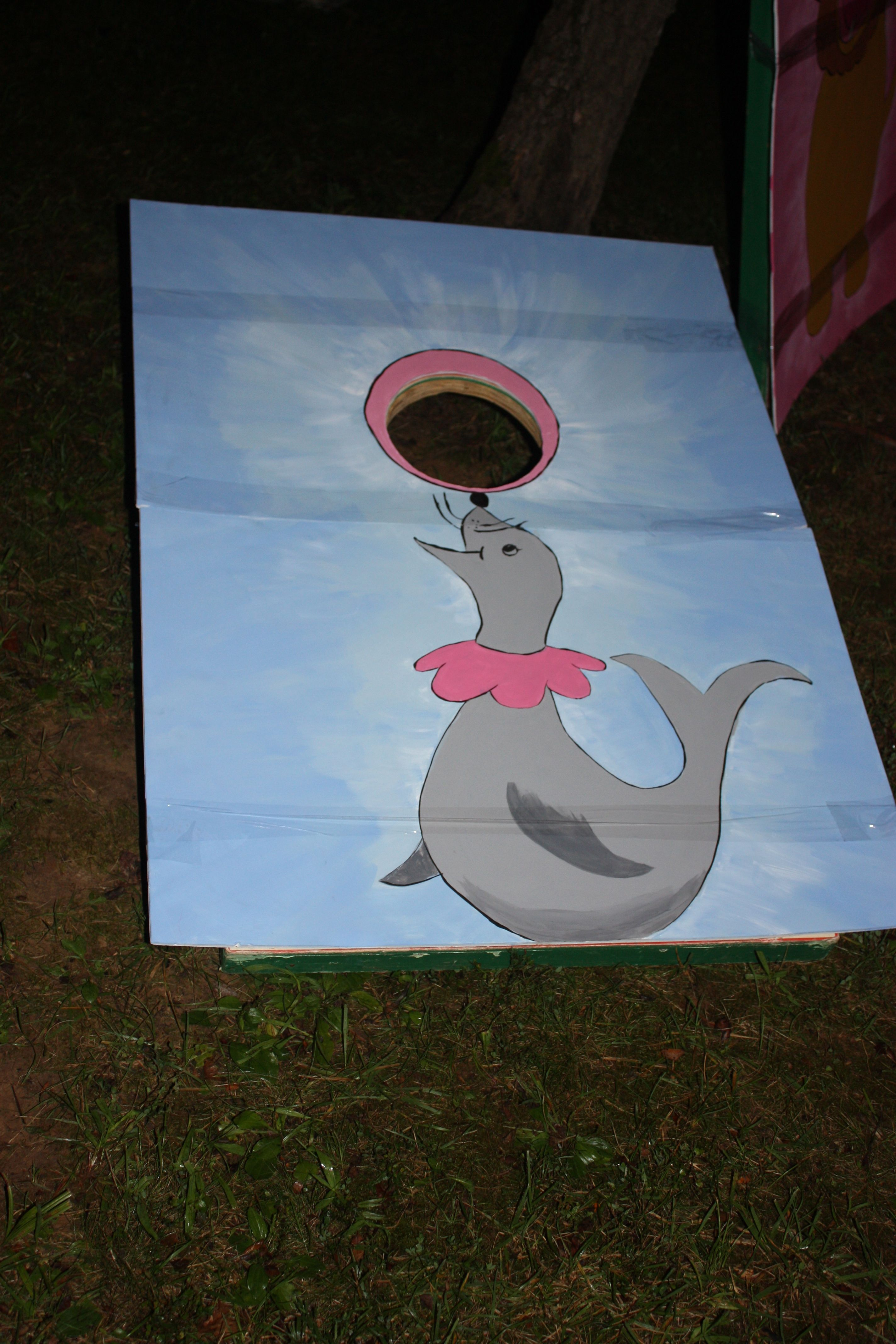 Feed the seal and lion tamer bean bag toss game. artist painted ...