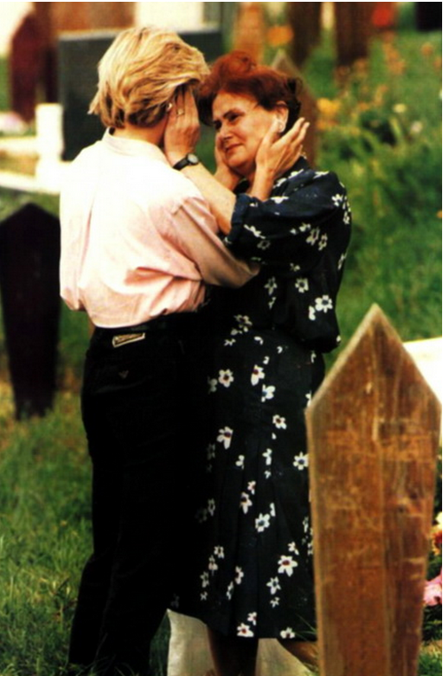 Princess Diana comforts a crying woman during her visit to