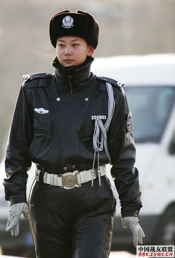 Chinese policewoman in full leather uniform