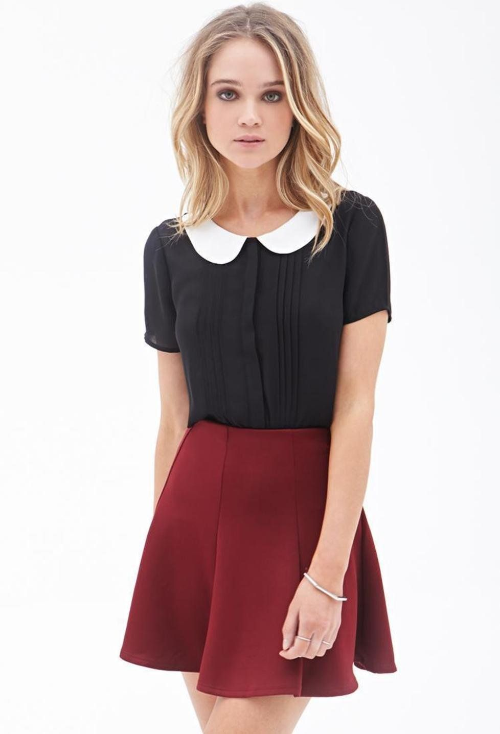 This is an example of a peter pan style collar. A peter pan collar has  rounded ends. This woman is wearing her peter pan collar top with a red  skirt, ...