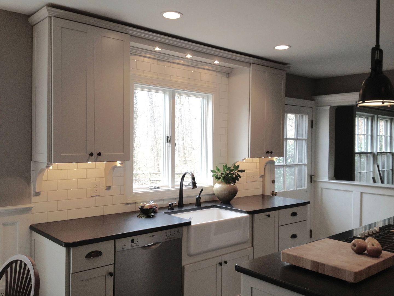 Simple White Kitchen Remodel With Honed Granite Countertops Farm Sink White Subwa White Kitchen Remodeling Kitchen Bathroom Remodel Honed Granite Countertops