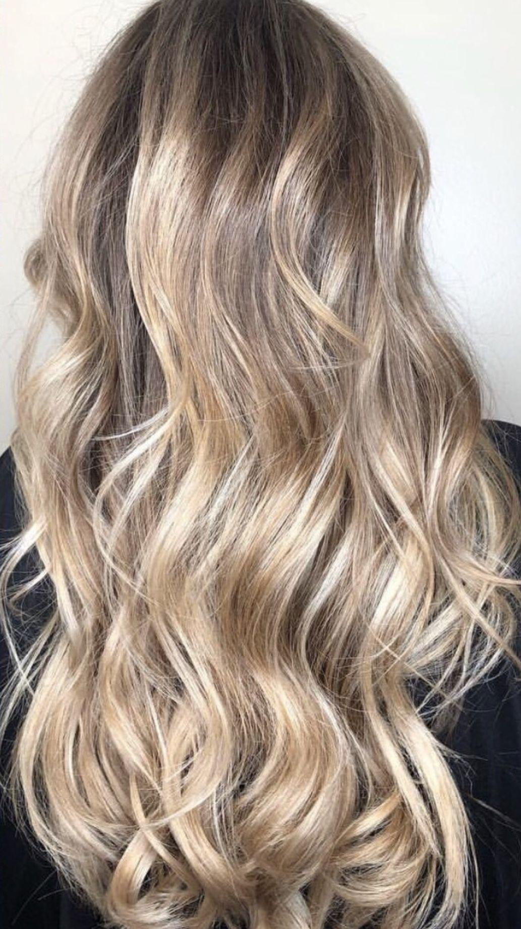 Icy blonde balayage hair blonde balayage curly icy longhair
