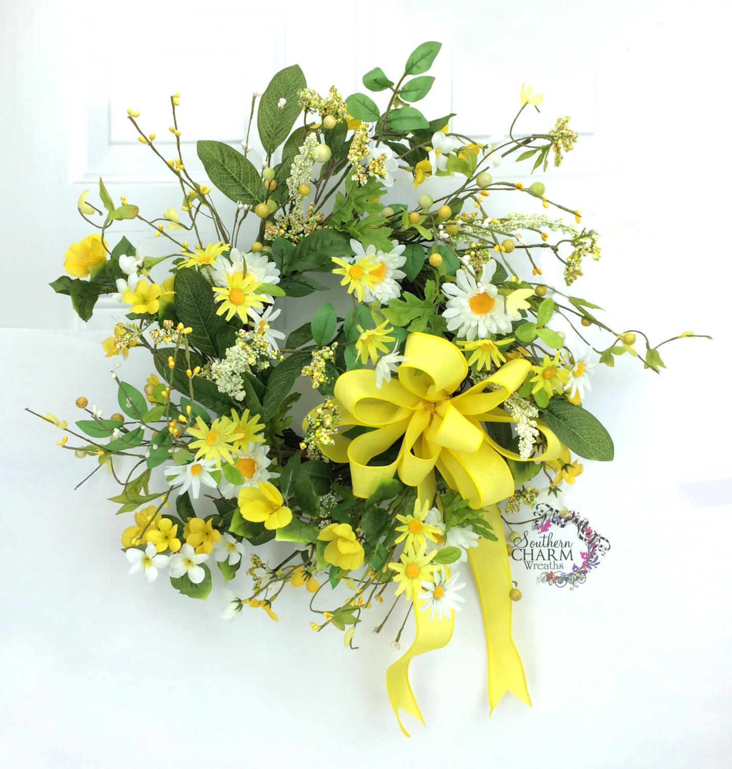 Spring daisy wreath in yellow and white with berries and bow