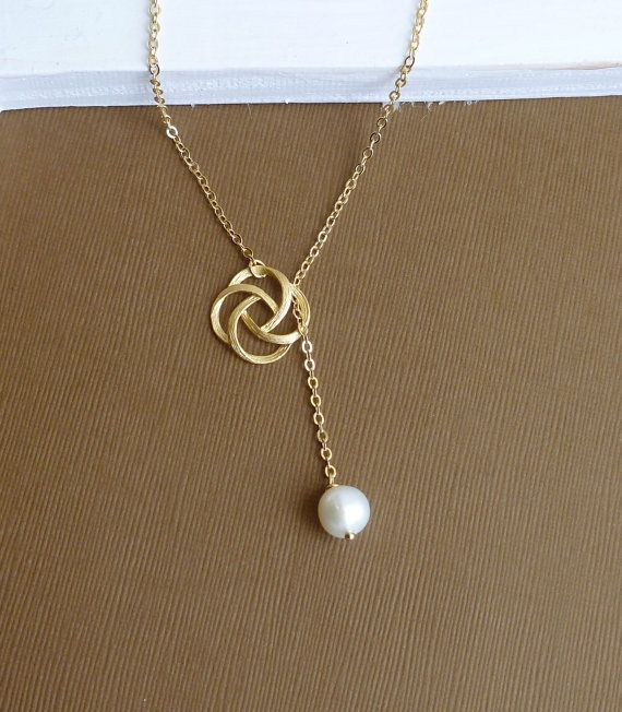 Love this! Gold Rose Swirl and Ivory Freshwater Pearl -- Gold Lariat Necklace. $17.00, via Etsy.