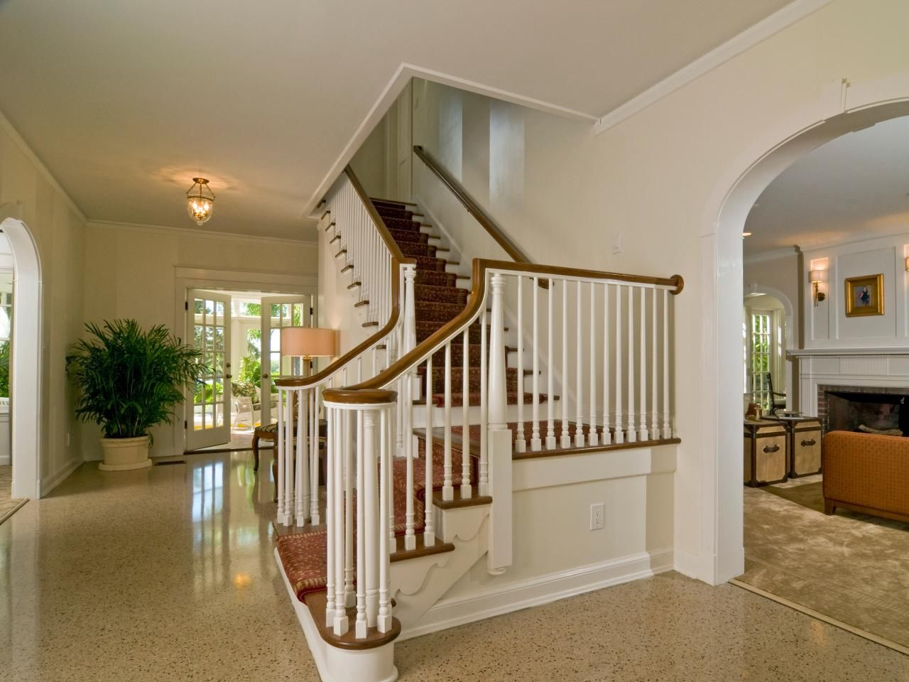 Entry Foyer Runner : This traditional foyer features terrazzo flooring and an elegant