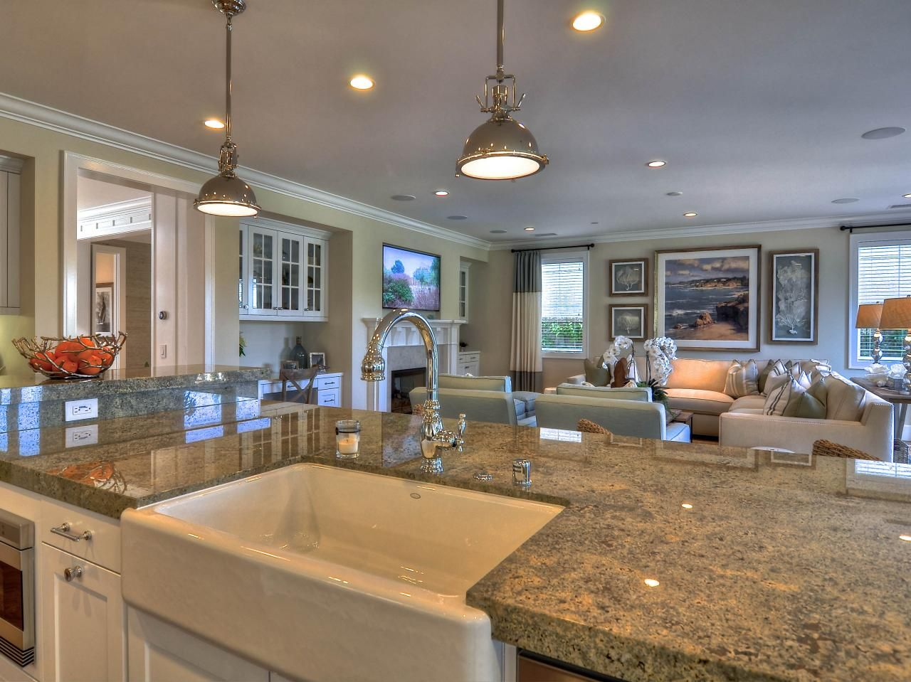A Large Granite Topped Kitchen Island Adds Plenty Of Functional Space For Food Prep While