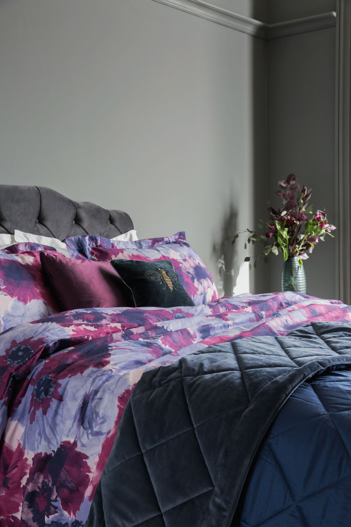 Purple Bedding Mixed With Dark Blue Accessories And Grey Walls