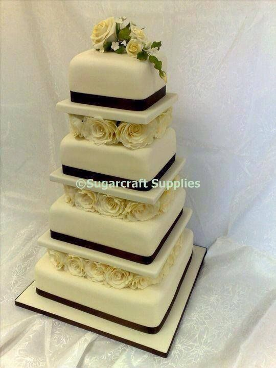 Four tier ivory wedding cake seperated by cream sugarflower roses four tier ivory wedding cake seperated by cream sugarflower roses junglespirit Gallery