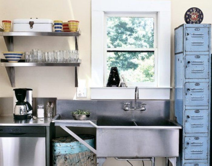 Reuse kitchen. Stainless restaurant sink and counter. Old lockers ...