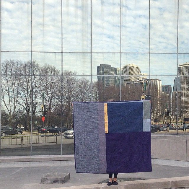 "Artist Heidi Parkes with her quilt, ""Night and Day,"" in front of The School of the Art Institute of Chicago. #quilt #handquilted #art"