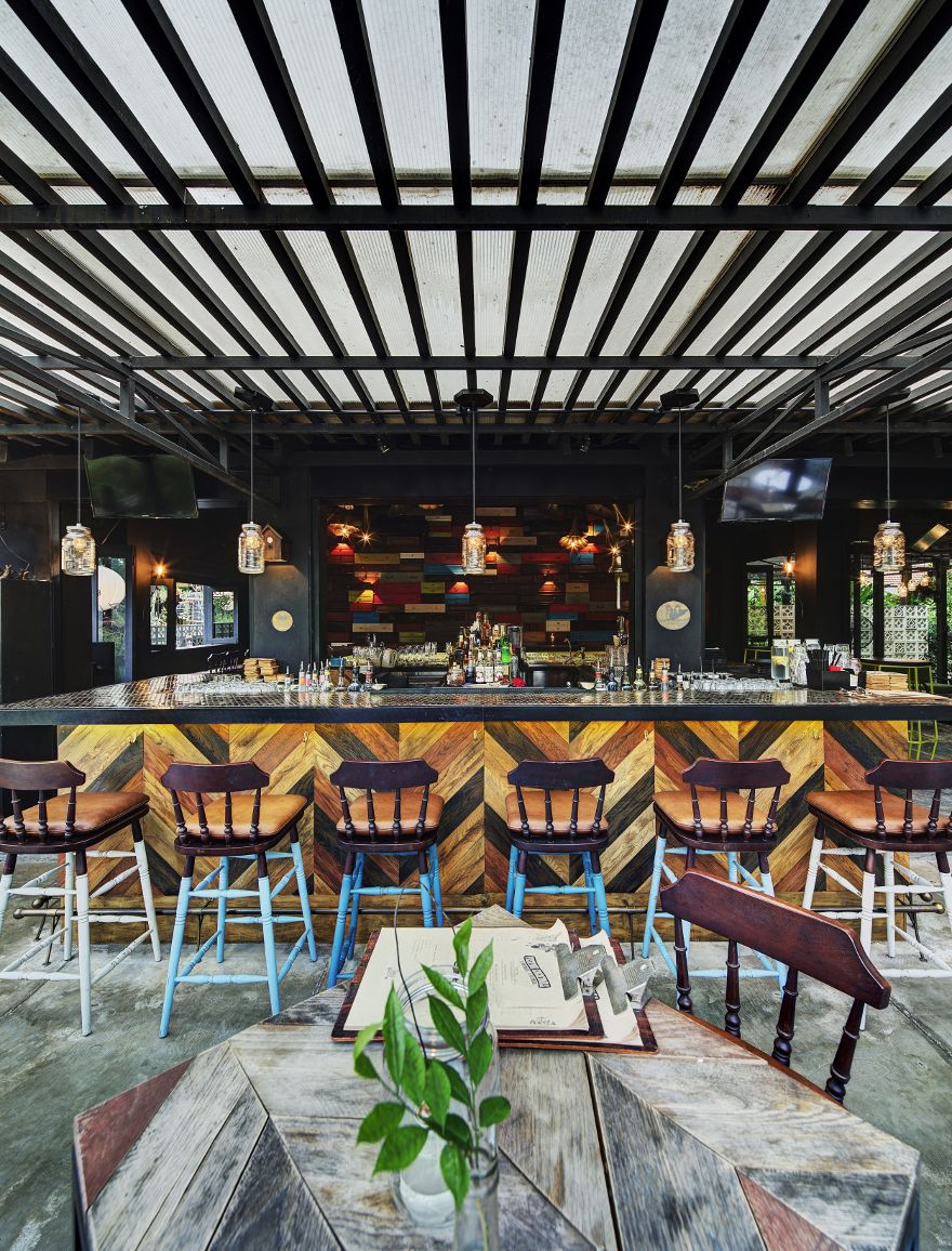The green door an oasis of greenery in singapore is the bar to