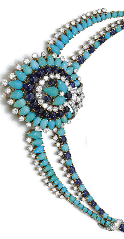 TURQUOISE, SAPPHIRE AND DIAMOND NECKLACE , BULGARI The necklace decorated to the centre with a pear-shaped motif in graduated lines of turquoise, cabochon sapphires and brilliant-cut diamonds, the central motif may be detached and worn as a brooch, signed Bulgari.