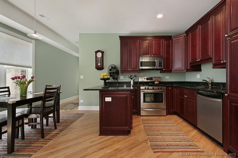 superior Kitchen Wall Colors With Dark Brown Cabinets #4: of the Day: This small kitchen features traditional rich cherry cabinets,  light green walls, and light wood floors set at an angle.