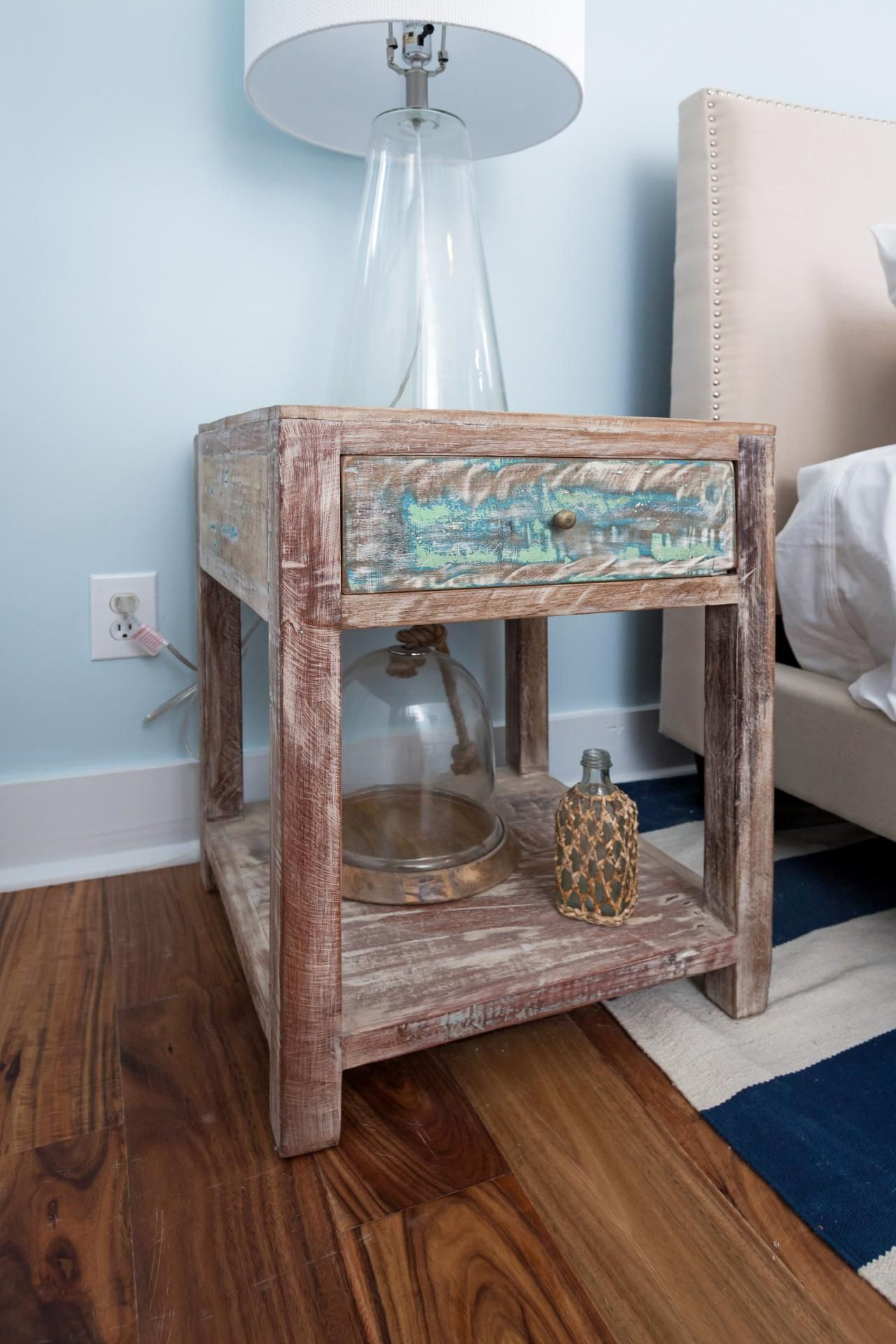 Master bedroom nightstand decor  As seen on Beach Flip decorations include a beach style nightstand