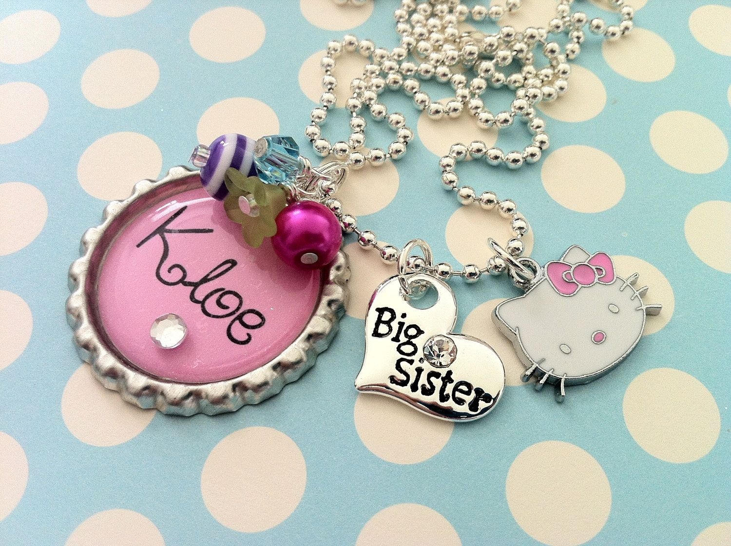 Personalized Girl's Charm Necklace Pink Big Sister Bottle Cap Children's Jewelry Gift. $23.00, via Etsy.